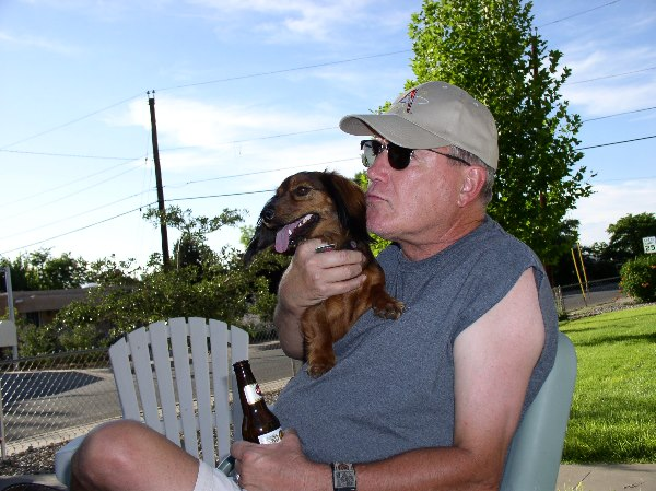 Don being goofy, siting on the front porch with Baby Girl